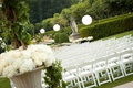 Wedding ceremony seating of white chairs set on a lawn of Oheka Castle