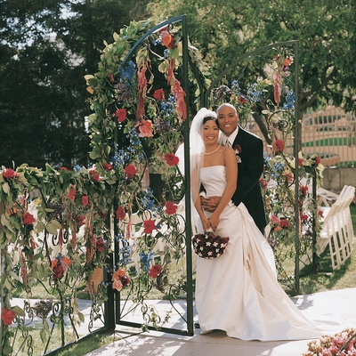 Entrance to ceremony through floral gate