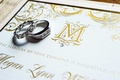 Megan Wollover and Tracy Morgan wedding invitation with gold letterpress and monogram with rings