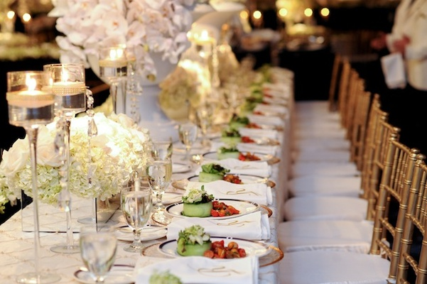 Dinner courses on long reception table