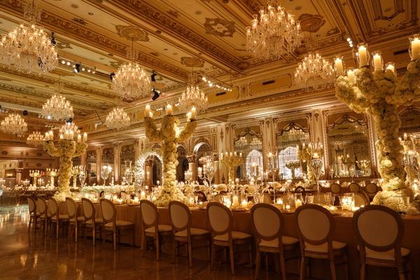 wedding reception in luxury ballroom the mar a lago club tall centerpiece candelabra covered roses