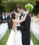 Newlyweds embracing on outdoor wedding aisle