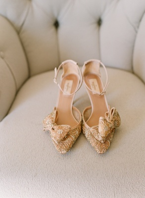 Champagne-hued heels with ankle strap and bow