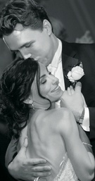 Black and white photo of newlyweds embrace