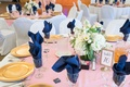 simple pink blue gold tablescape low florals table number white chair covers california wedding