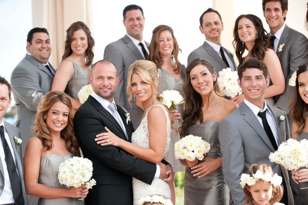 Bridesmaids in grey dresses and groomsmen in suits