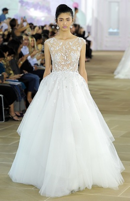 Sleeveless soft ball gown with floral embroidered illusion bodice and soft layered tulle skirt with