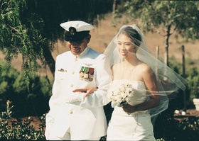 Military father of the bride walks bride down the aisle