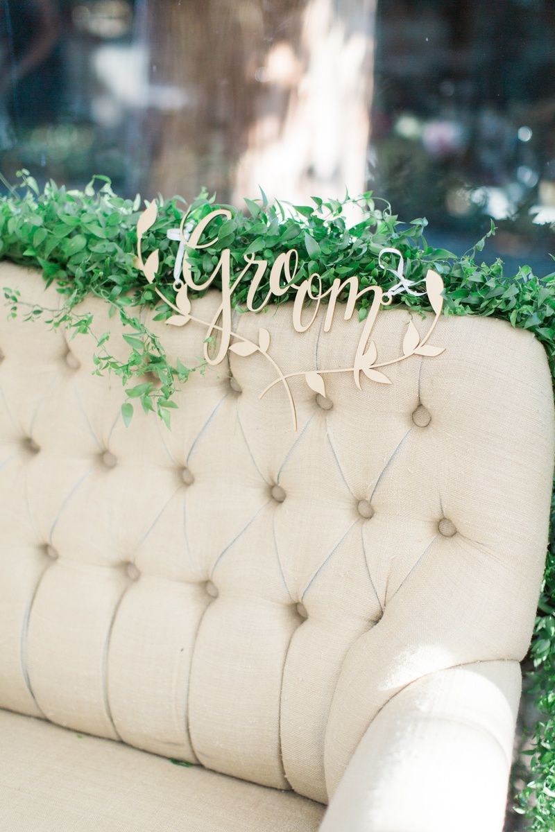 love seat for sweetheart table with gold groom sign