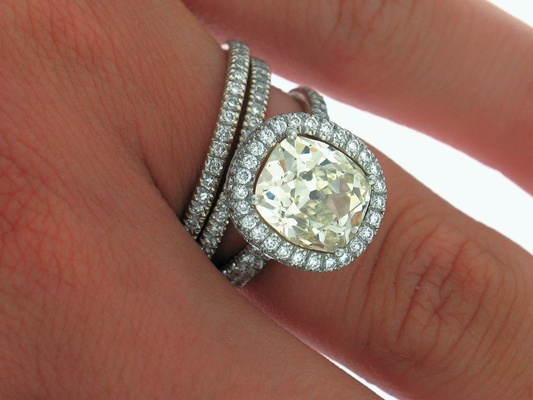 Fancy yellow diamond halo engagement ring