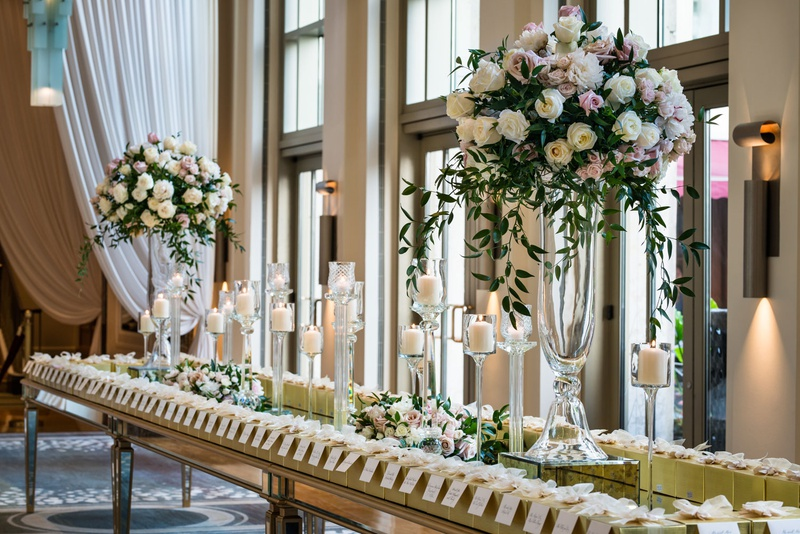wedding reception mirror gold table candles tall flower arrangements escort cards gold boxes favors