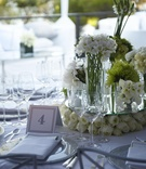 Wedding centerpiece with many vases filled with white flowers