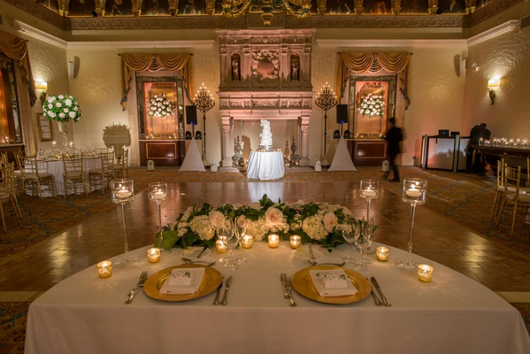 the breakers wedding reception, half circle sweetheart table with florals and candles