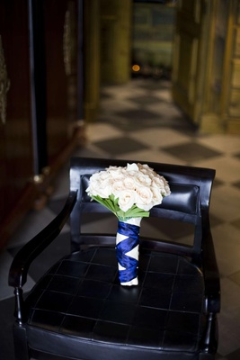 Ivory roses wrapped in blue and white ribbons
