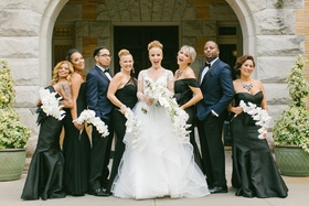 bride in hayley paige, bridesmaids in black lazaro and amsale, bridesmen in ike behar