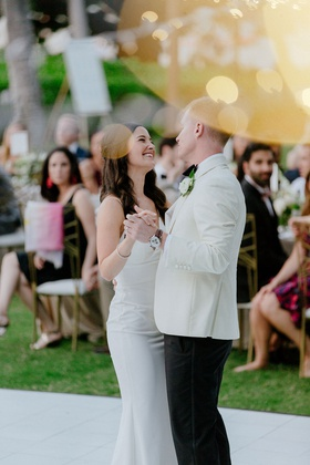wedding reception white dance floor outdoor hawaii venue gold chairs white tuxedo jacket crepe dress