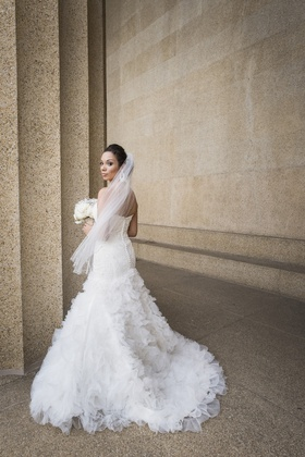 Bride in a strapless Mark Zunino dress with buttons down back,