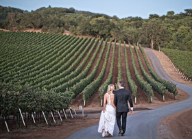 Bride in Bella Bianca Bridal Couture wedding dress y back with groom in wine country kenwood ca