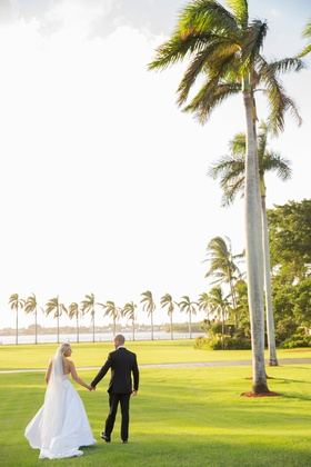 Wedding portrait couple bride and groom tuxedo veil tall palm trees