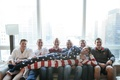 veteran groom in american flag onesie lounges on his groomsmen
