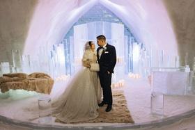 bride and groom portrait ice castle wedding chapel snow floor faux fur rugs throws