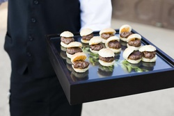 Shadow box topped with mini beef burgers