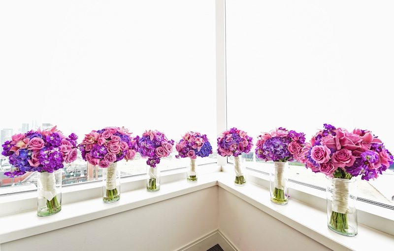 Bridesmaid bouquet of violets, light purple rose and orchid flowers