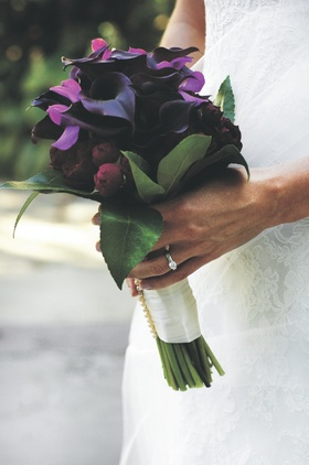Brides bouquet of dark colored flowers