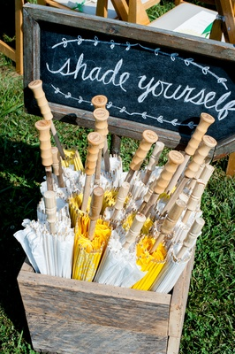 Shade Yourself sign with yellow and white ceremony parasols