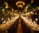 Wedding reception in New York with long rectangle tables glass orbs greenery orchids reception hall