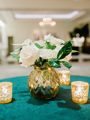cocktail hour table emerald green velvet linen gold vase white roses green leaves candles