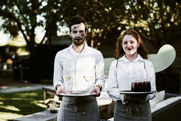 halloween wedding reception servers in halloween costume makeup holding trays