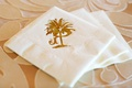 Wedding cocktail napkins stamped with the couple's gold crest