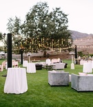 large lounge area farmhouse lawn faux wedding party styled shoot rustic event fairy lights tables