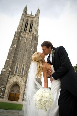 couple kisses outside Duke University Chapel