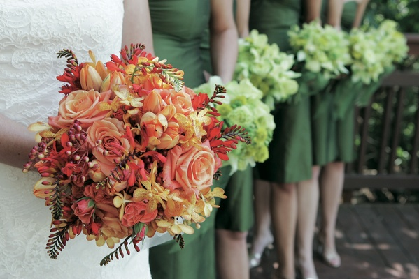 Bride's red bouquet with bridesmaids' green bouquets