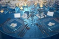 Blue tablecloth with blue napkins and sliver charger plates