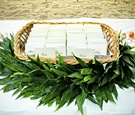 Green garland around basket of seating cards
