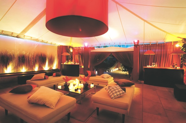 Tented reception lounge area with cushioned benches