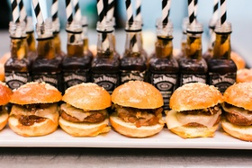 Wedding hors d'oeuvres barbecue slider burger sandwiches with jack daniels straws