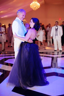 Bride in black Vera Wang wedding dress with father of bride dancing