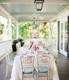 wedding reception wraparound porch southern destination wedding pastel color palette gold chairs