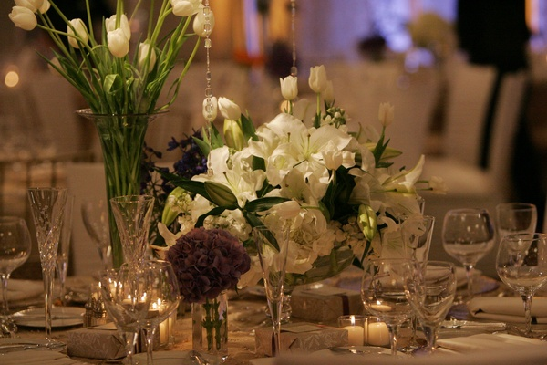 Votive candles and low floral arrangements
