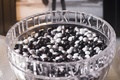 Wedding reception with ebony & ivory M&Ms stamped with XV in crystal bowl with Roman numeral rim