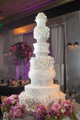 Tall wedding cake with crystals and sugar flowers