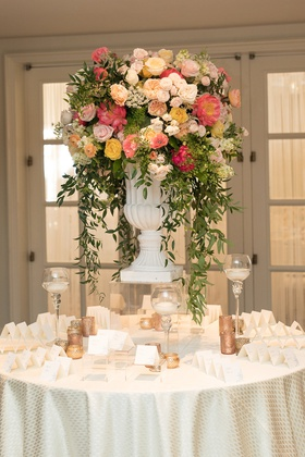 wedding reception escort card table pink orange yellow rose peony flowers greenery escort cards