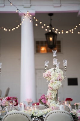 wedding reception candelabra covered with white hydrangeas and pink florals