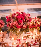 wedding reception tall centerpiece pink roses and greenery candles gold chairs crystal glassware