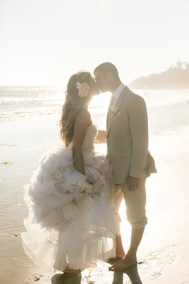 Tone It Up Katrina Hodgson wedding dress Monique Lhuillier flower in hair tan groom's suit on beach