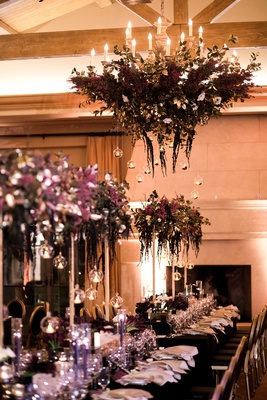 deep purple floral chandelier with glass globes hanging down